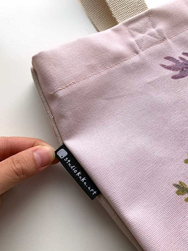 pink tote brand tag