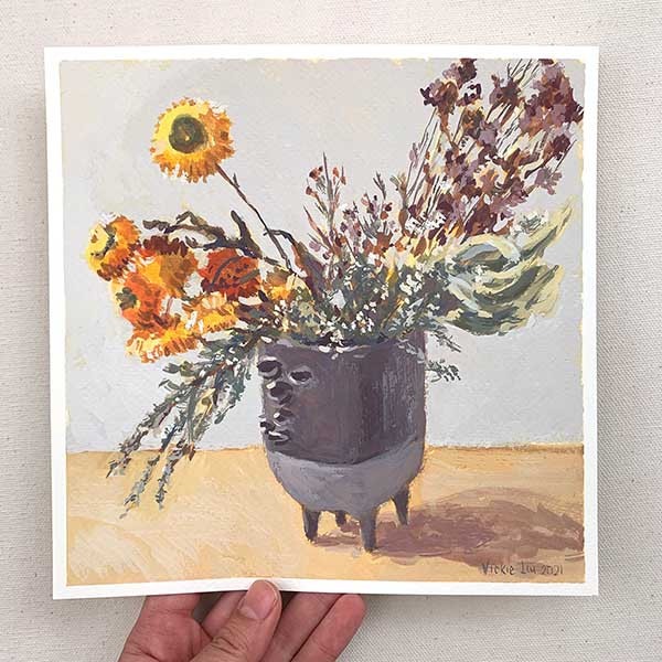 dried paper flowers in banksia vase still life